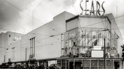 Workers install the three-story display window on the Sears store at the intersection of North Avenue and Harford Road prior to its opening in 1938.