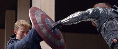 "Captain America/Steve Rogers (Chris Evans) and Winter Soldier/Bucky Barnes (Sebastian Stan) fight in ""Marvel's Captain America: The Winter Soldier."""