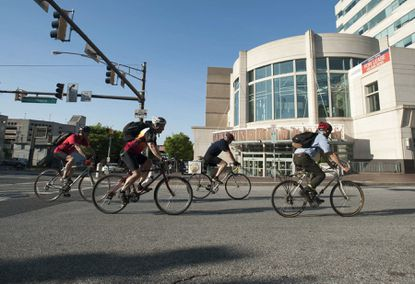 A group of local cyclists ride their bicycles through Towson.