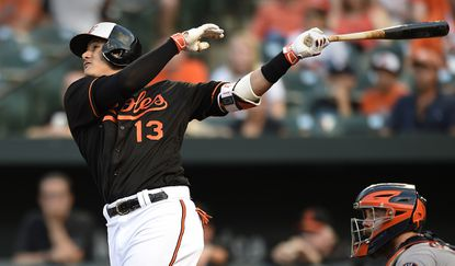 Baltimore Orioles' Manny Machado follows through on a two-run home run against the Houston Astros during the first inning of a baseball game Friday, Aug. 19, 2016, in Baltimore.