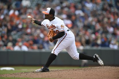 Orioles pitcher Mychal Givens throws a pitch to the Detroit Tigers in a baseball game, Sunday, May 15, 2016, in Baltimore.