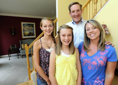 Dave and Nancy Becker and their daughters Hayley, 14, and Taylor, 11 (yellow top).