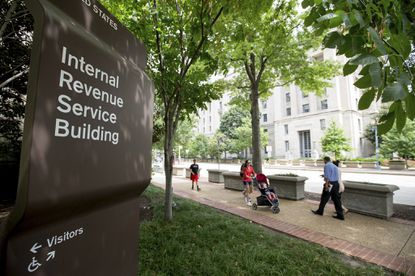 This Aug. 19, 2015, photo, shows the Internal Revenue Service Building in Washington. Many Americans have rushed to prepay their 2018 property taxes to save on their federal taxes, hoping to take advantage of a deduction before it is scaled back under a new law.