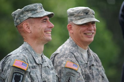 Left to right, Col. Brian P. Foley and Col. Edward C. Rothstein share a laugh during the Change of Command Ceremony on the McGlachlin Parade Field. Foley replaces Rothstein as commander of Fort George G. Meade.