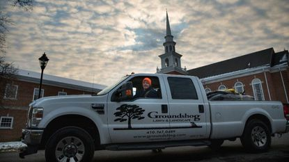 Joe Coates, owner of Groundshog Lawn and Landscape, stops by his Christmas tree lot in Catonsville in December 2017.