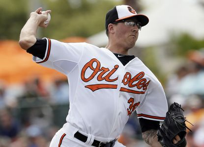 Kevin Gausman throws during the fourth inning of a spring training exhibition game March 10.