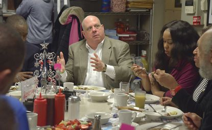 Gov. Larry Hogan breakfasts at Jimmy's with Taylor Alexander of Flawless Damsels (right) and other business and community leaders.