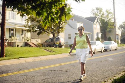 Emma Pennington, founder and president of the Winters Lane Advisory Board, walks around her neighborhood on Saturday, Aug. 31. Pennington, an active member of the community, said she isn't going to let the recent shooting in the neighborhood deter her from her regular walks.