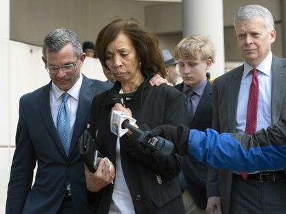 In this Feb. 27, 2020, file photo, former Baltimore mayor Catherine Pugh, second from left, and her attorney Steven Silverman, left, leave a sentencing hearing at U.S. District Court in Baltimore.