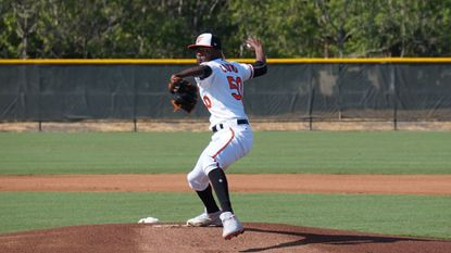 "Orioles right-hander Miguel Castro delivers a pitch on Friday morning during a ""B"" game against the Pittsburgh Pirates."
