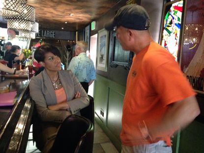 Mayor Stephanie Rawlings-Blakespoke to a man atBar Liquorice in Riverside during a campaign happy hour on Monday.