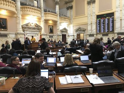 House members take a short break during the General Assembly's most recent session. A proposed state constitutional amendment to give lawmakers greater power to add or shift money within the budget faces the voters this year as Question 1 on the General Election ballot.