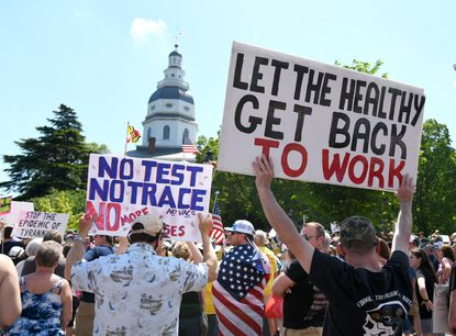 On State Circle in Annapolis, the group ReOpen Maryland held a rally to get Maryland Governor Larry Hogan to do away with COVID-19 restrictions completely last May. File.