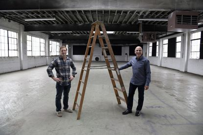 Eben Altmann, left, and Jonathan Fishman are partners in B-More Kitchen, a community kitchen where entrepreneurs can incubate their food businesses.