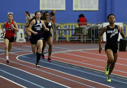 Teanna Jules of Howard is seen racing in the girls 500-meter run at last winter's Howard County championship meet. This year's Howard County meet has been canceled because of snow.