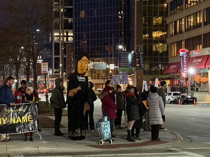 About 30 people gathered downtown during Thursday's afternoon rush hour at the corner of Light and Pratt streets in McKeldin Park to protest a potential war with Iran. Jan. 9, 2020