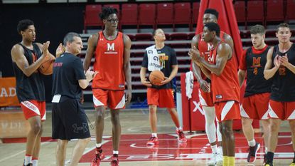Maryland coach Mark Turgeon talks to some of his players, including former Mount Saint Joseph star Jalen Smith (wearing goggles) during a recent practice at Xfinity Center.