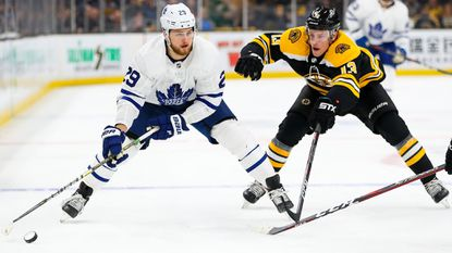 Toronto Maple Leafs' William Nylander (29) skates with the puck trailed by Boston Bruins' Charlie Coyle (13) in the second period of Game 1 of the Eastern Conference first round during the NHL playoffs on Thursday.