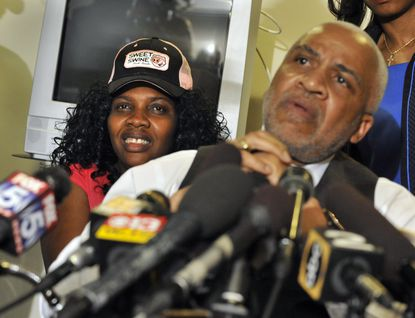 Attorney Edward Smith Jr. appears with client Mirlande Wilson, who claimed to have won the Mega Millions.