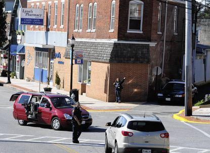 """A Havre de Grace police officer directs traffic as filming for """"House of Cards"""" on Washington Street in Havre de Grace continued Wednesday."""