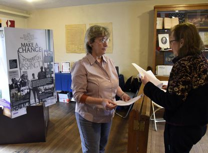 Kathy Fuller and Cathey Allison volunteer to teach visitors about the United States Bill of Rights at the Carroll County Farm Museum in Westminster on February 25, 2017.