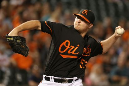 Closer Zach Britton delivers a pitch in the ninth inning of the Orioles' 5-4 win over the Rays at Camden Yards on September 16, 2016.