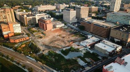 Towson Row, a $350 million, 5-acre mixed-use development, stalled in 2015 after excavators hit solid rock making the underground parking lot an impossibility. Since then the project has been redesigned and the first component is expected to be completed in late 2020.