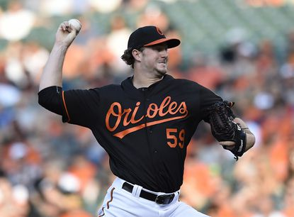 Orioles pitcher Mike Wright throws to the Toronto Blue Jays in the first inning of a baseball game, Friday, June 17, 2016, in Baltimore.