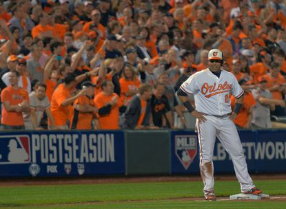 Orioles designated hitter Nelson Cruz smiles at third base during Game 1 of the American League Division Series against Detroit at Camden Yards.