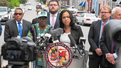 Baltimore City State's Attorney Marilyn Mosby holds a press conference in Sandtown at Mount and Presbury streets.