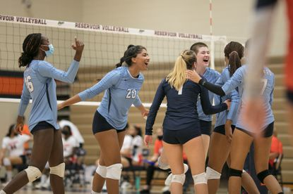 Howard players cheer after a huge score over Reservoir in the first set. Howard varsity volleyball at Reservoir High School, September 13, 2021. Photo by Nate Pesce for Baltimore Sun Media