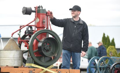 Brian Bowman of Manchester works on getting the gears of his International Harvester 3hp Vertical Famous engine spinning during the Maryland Steam Historical Society's Spring Crank Up at the Upperco Carnvial Grounds on Saturday, April 17, 2021.