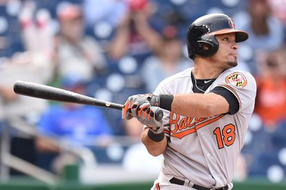 Gerardo Parra of the Baltimore Orioles singles to lead off the game in the first inning during a baseball game against the Washington Nationals at Nationals Park on September 24, 2015 in Washington, DC.