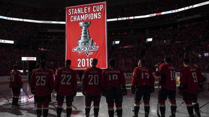 The Washington Capitals watch the franchise's first championship banner get raised to the rafters at sold-out Capital One Arena before their season opener against the Boston Bruins. The red-clad crowd was treated to one more sighting of Alex Ovechkin holding the Stanley Cup.