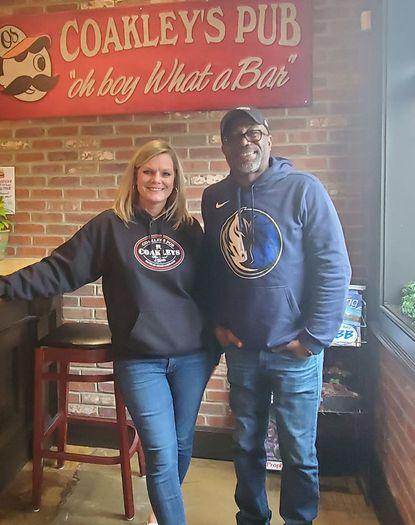 Darius Rucker, country music singer and frontman for Hootie and the Blowfish, poses with Margie Coakley, the owner of Coakley's Pub in Havre de Grace. Rucker visited the restaurant with his family for lunch on Wednesday, Dec. 4.