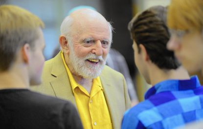 "In this July 2014 file photo, John Astin, who played Gomez in the 1960s TV show ""The Addams Family,"" speaks to students participating in a summer theater camp at Glenelg High School, where they were to perform the Broadway play of the same name."