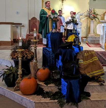 Locally, the tradition of honoring first responders is a result of the extraordinary efforts of Father Mark Bialek at St. John Catholic Church. In this photo, Father Mark officiates the October 20, 2018 Blue Mass.