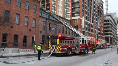 Baltimore firefighters respond to a small fire on the roof of Bar Vasquez in Fells Point Monday morning.