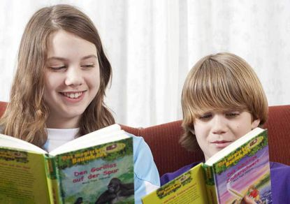 Sophia Fetzer, 12, and Jonah Fetzer, 10, speak German and Spanish in addition to English. Their parents encourage them to read books in all three languages. P
