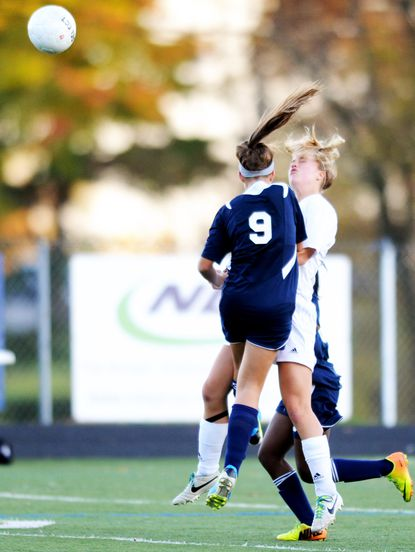 Perry Hall's Taylor Francis, left, and Catonsville's Renee Gast nearly knocked heads during the regional semifinal soccer match at Catonsville High School last year. On Wednesday night, Francis and Gast each had a goal as the two teams played to a 1-1 overtime tie.