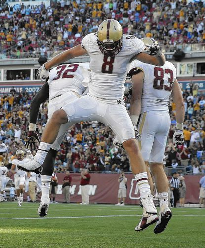 Boston College wide receiver Josh Bordner (8) celebrates his touchdown with teammates wide receiver Charlie Callinan (83) and running back Jon Hilliman (32) during the fourth quarter of an NCAA college football game in Foxborough, Mass., Saturday, Aug. 30, 2014. Boston College won 30-7. (AP Photo/Michael Dwyer)_- Original Credit: AP