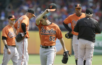 Baltimore Orioles starting pitcher Miguel Gonzalez (50) leaves a baseball game during the sixth inning against the Texas Rangers in Arlington, Texas, Sunday, Aug. 30, 2015. The Rangers won 6-0.