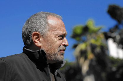 Former Secretary of Labor Robert Reich awaits his introduction to speak to Occupy Los Angeles protesters in 2011.