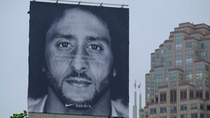 A billboard featuring Colin Kaepernick as part of Nike's new ad campaign stands atop a building housing a Nike store in San Francisco.