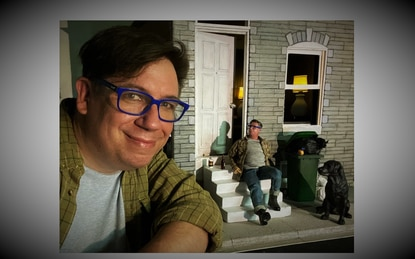Baltimore artist Tony Shore with his miniature doppelganger, Tiny Tony, his dog, Begley, and his overflowing trash can. (Baltimore Sun staff).