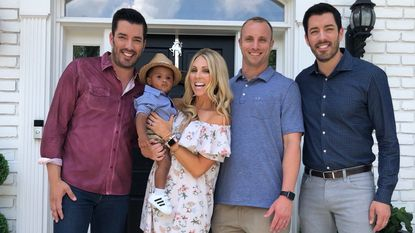 """From left: Jonathan Scott, Asher Reimold, Jenny Reimold, Nolan Reimold and Drew Scott pose for a photo in front of the Reimolds' Franklin, Tenn., home, which was filmed for an upcoming episode of """"Property Brothers."""""""