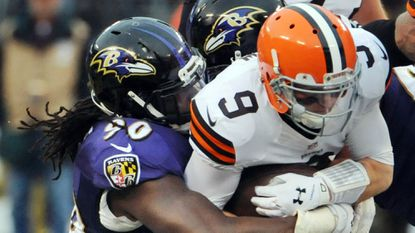 Ravens linebacker Pernell McPhee, left, sacks Cleveland Browns quarterback Connor Shaw in the third quarter.