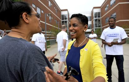 Donna Edward talking with Carol Chin outside Charles Herbert Flowers High School in Greenbelt on the primary election day.