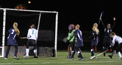 Catonsville High junior Brooke Stevens leaps in the air to celebrate her game-tying goal as Comets teammates, from left, Grace Campbell, Catherine Sweeney and Emma Clark look on in the Comets' 2-1 triumph in the Class 4A state semifinals.