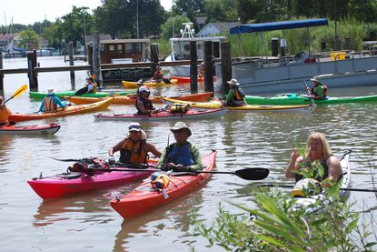 Kayakers take to the water after Wednesday's official opening of the new water access area at Shady Side Park. The facilities are part of an effort to open more water access points for residents. Photo courtesy Anne Arundel County Department of Recreation and Parks